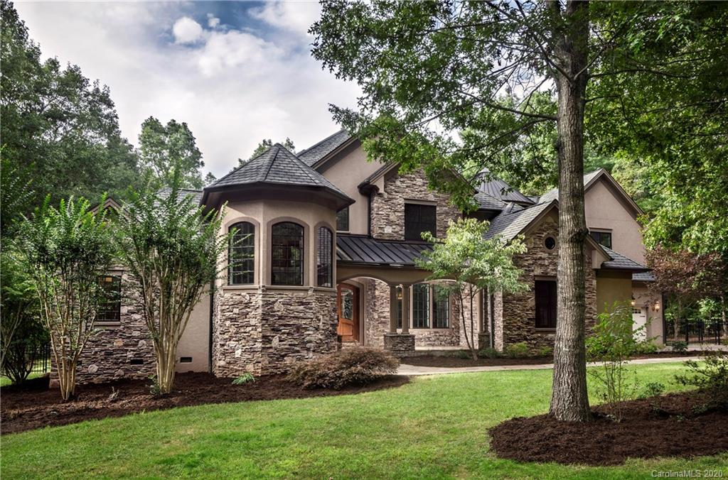 """Make sure to share the innovative Virtual Tour -- a """"Dogumentary"""" with your clients! https://youtu.be/lyCBSGripXU  On the market for the first time since the original build, this custom home is conveniently located in the desirable Cane Creek area. Nestled in two acres of woods, it is private and quiet -- a cocoon for the busy family. Numerous flex spaces offer at least two offices and a study/play area or media room. The open plan chef's kitchen together with the great room form the heart of the home, a place for all to gather. Entertaining will be a breeze, with a formal dining room. The main level offers a master suite wing as well as direct access to the pool, patio, and pool house. Upstairs are three bedrooms, each with an en suite bath, and two flex spaces. On the mezzanine level at the front of the house is your bay window-lined office. Freshly painted and with newly refinished Brazilian Cherry hardwood floors, this home is move-in ready for the most discriminating buyers!"""