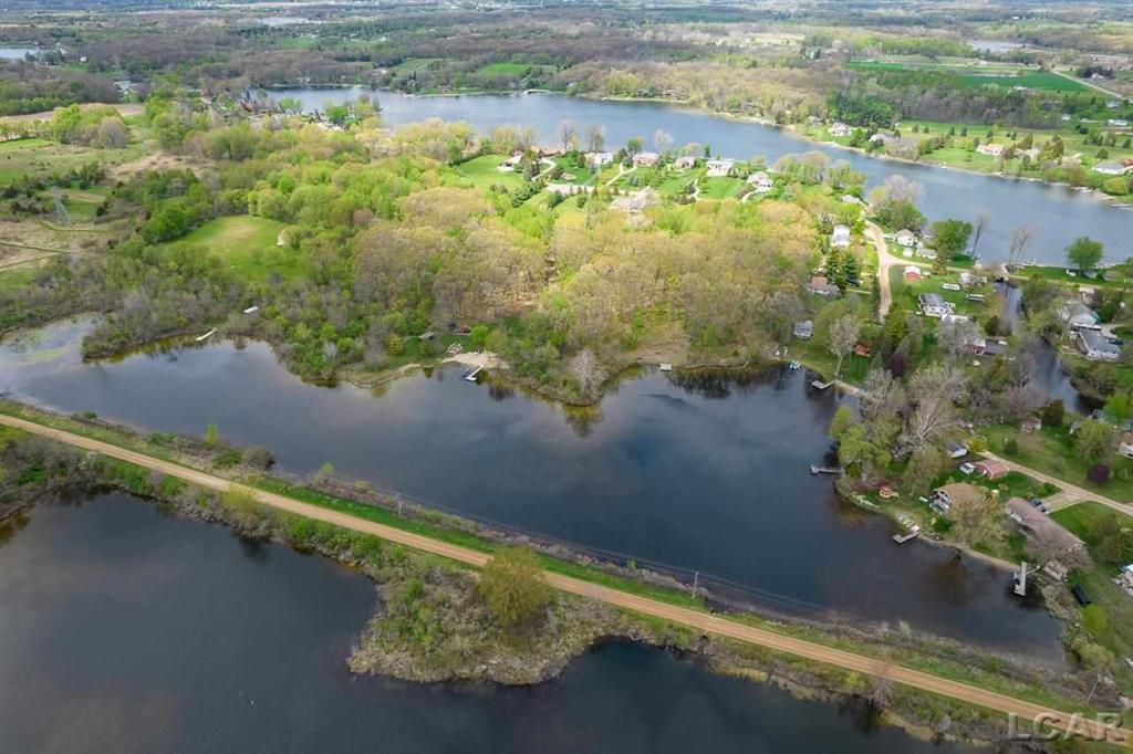 12.95 Acres, over 350+ Lake frontage on All Sports Mercury Lake! Take the canal from Mercury Lake to 110-Acre All Sport South Lake! Just in time for fishing, boating and water sports! Perfect home build site with waterfront, woods, natural gas and electric at street. Property is on well and septic which is not currently installed, property has perked in the past. Easy drive to conveniences! Onsted Schools district.