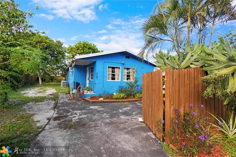 A perfect gift to yourself this holiday season.  Whether you're a first time buyer or an investor, the quiet Rock Island Neighborhood is one of the most convenient places to live in Broward County. Easy access to both 95 and the Turnpike and minutes to Downtown or Wilton Manors. This Florida Style Shotgun house is ready for your personal touches.  A/C and Water heater in 2011.  Newer Washer and Dryer.  Situated on a private, fenced lot with no rear neighbor.  Home gardener's paradise with Mango, Avocado, Soursop and Sapodilla trees and Tomato, Pepper Cabbage, Pineapples and fertile soil for your veggies.  Close to schools, parks and houses of worship.