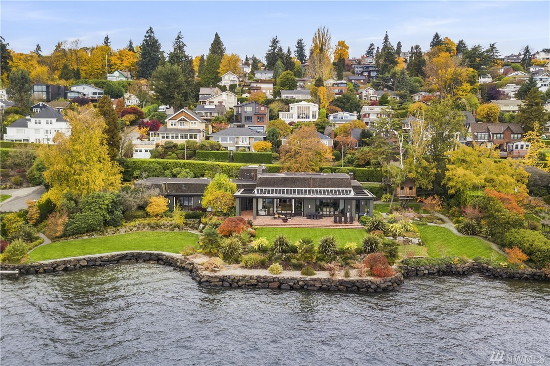 Privacy & elegance along the shores of Lake Washington! With a sophisticated & timeless relationship to the water, front row views of Mt Rainier & the Cascades & 180 front feet of the lake, this nearly one level home features 4 en-suite bedrooms, a beautifully appointed kitchen & an open floor plan that embraces the indoor/outdoor living, lively water views, and the light. Immaculate grounds & mature landscaping of lush lawns, brick patios & stone pathways convey extraordinary lakeside living.