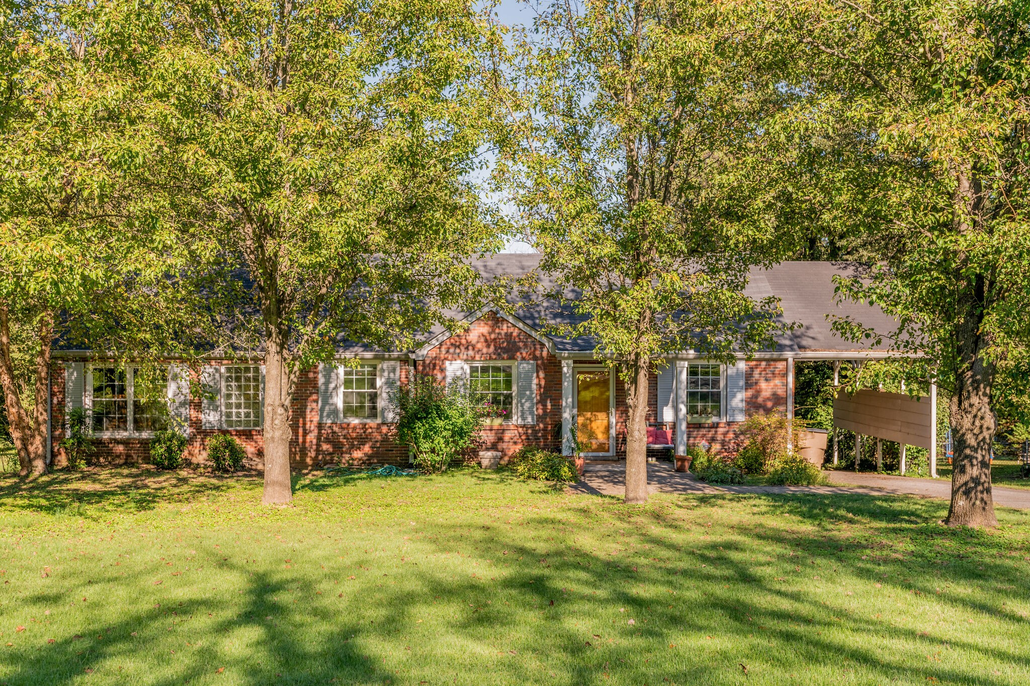 Awesome Inglewood location! Move in ready all brick cottage! Nice hardwoods & big family room w/ half bath & access to covered deck. Great backyard & carport! Big bedrooms! Home has had an addition so tax record square footage is not correct. Really must see in person!