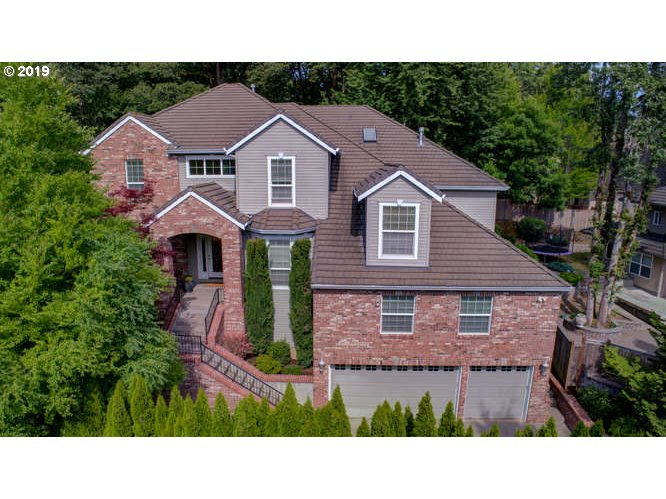 Open 1-3:00pm July 14th.Tucked away in the heart of one of West Linns finest neighborhoods this home is sophisticated & family friendly.Striking entry with 19 ft ceiling,Brazilian cherry staircase & floors,chefs kitchen,greatroom & formal areas architecturally defined by stunning millwork. Office & 2 bonus rooms offer fantastic separation of space.Welcome family & friends to the private yard with a 500sqft deck,perfect for entertaining!