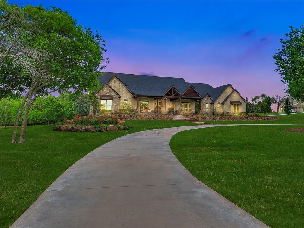 Breathtaking Custom Extremely Efficient Home on 2 wooded acres in East Edmond inside a gated estate development.Lush Landscaping which is fully irrigated&complete w/landscape lighting.700 sqft of covered porches,outdoor kitchen complete w/ sink,grill flat iron grill,side burner,fridge,&17ft bar,outdoor fireplace,stained&stamped porches w/ bull nose edging front & back.A large circle drive,Gorgeousstone wall, elegant stair front entrance, beautiful cedar beams throughout welcome you to your new home.Step inside&take in the view.Elegant windows,timeless wood floors,100 year old reclaimed brick accent walls,double stacked chiseled edge granite,double ovens,butlers pantry,under/over cabinet lighting, double stacked crown,solid core interior doors,vaulted ceilings,heated floors & double whirlpool tub in masterbath,7.2surround sound&bluetooth auto.in theatre w 22 in. of sound proof insulation,felt in floors,150 in.4K 3D projector,water softner&filtration system,class 4 impact resistant roof.