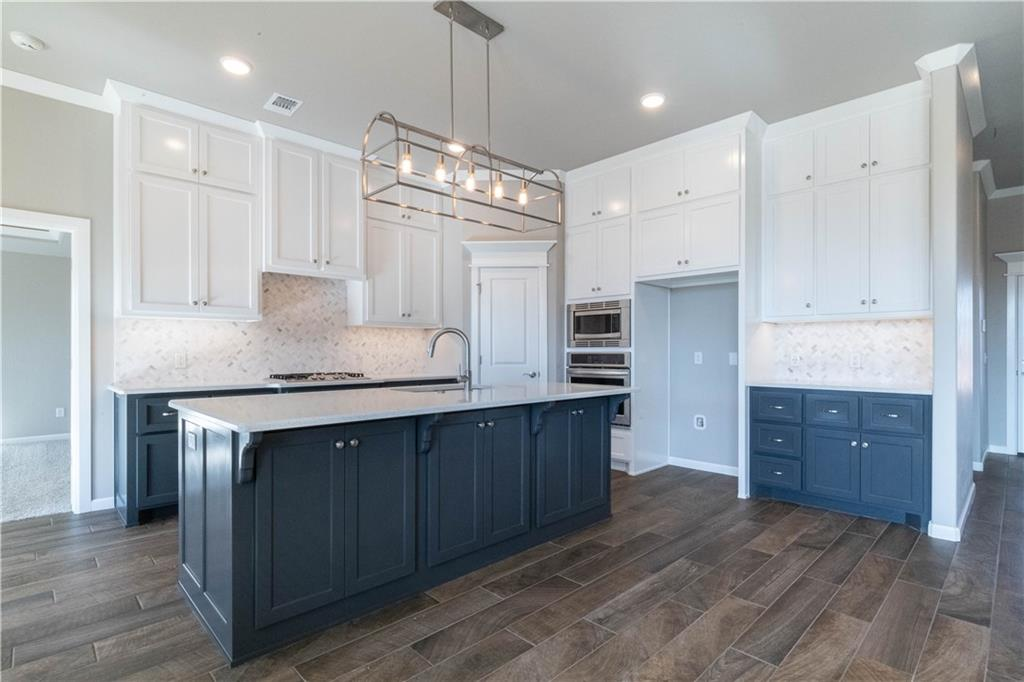 Discover the hospitality of Delmer Lakes, a close knit community, that stands for so much. Nestled in this Edmond Community, this Hazel Floorplan has so much to offer! Home includes 2,105 Sq Ft of total living space, which includes 1,900 Sq Ft of indoor living space and 205 Sq Ft of outdoor living space. Home has 4 bedrooms, 3 bathrooms and a 3 car garage. The living room has a corner gas fireplace with stack stone surround, 3 large windows, & barndoor. The kitchen has cabinets to the ceiling, built in stainless steel appliances, decorative backsplash, and 3cm quartz counter tops. The master suite boasts with ceiling detail, an attached bathroom with a dual sink vanity, walk in shower, whirlpool tub & large master walk in closet. The covered back patio and offers a wood burning fire place, tv and cable hookups, and a gas line for your grill. Other amenities include a whole home air filtration system, Rinnai Tankless water heater, R-44 insulation and a TechShield radiant barrier!