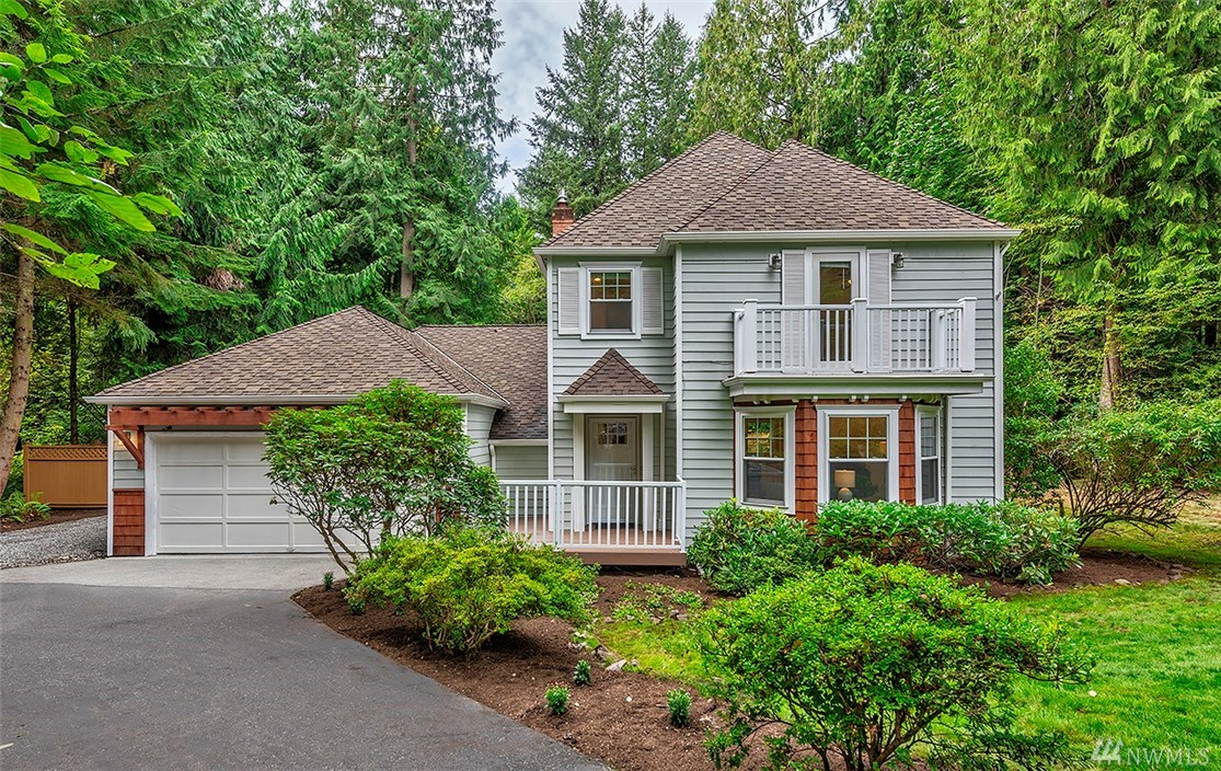 Nature provides the curb appeal for this Nantucket style home on a .913 acre lot. Open concept living. Gorgeous kitchen w/ induction range, granite counters & innovative storage. Great room design opens to huge deck, patio, & yard. Stunning koa wood floors, new carpet, new paint, new hall bath, newer windows & roof. Master suite w/ 5-pc bath, jetted tub, 3 closets & balcony. Private outdoor spaces, hot tub, play structure, sunny garden shed & raised bed garden. Minutes to Redmond/Microsoft.