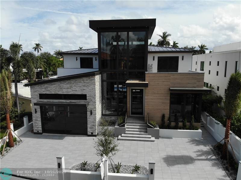 Take advantage of pre-completion pricing now! This new construction masterpiece offers the perfect opportunity to live your luxury lifestyle in Las Olas Isles! A grand entryway with a 32 foot ceiling, entrance waterfall and oversized pivot glass front door greets you and your guests. The first floor has an open floor plan with a chef's kitchen, dining and living area with a linear gas fireplace, game room with bar, 2 half baths, laundry room and owner's suite. The second floor features a catwalk with a stunning wet wall that leads to 4 additional ensuite bedrooms with balconies and a second laundry room. The backyard features a spa that cascades into a swimming pool, fire bowls, outdoor kitchen and concrete dock. This smart home has all high-end finishes plus a full-house generator.