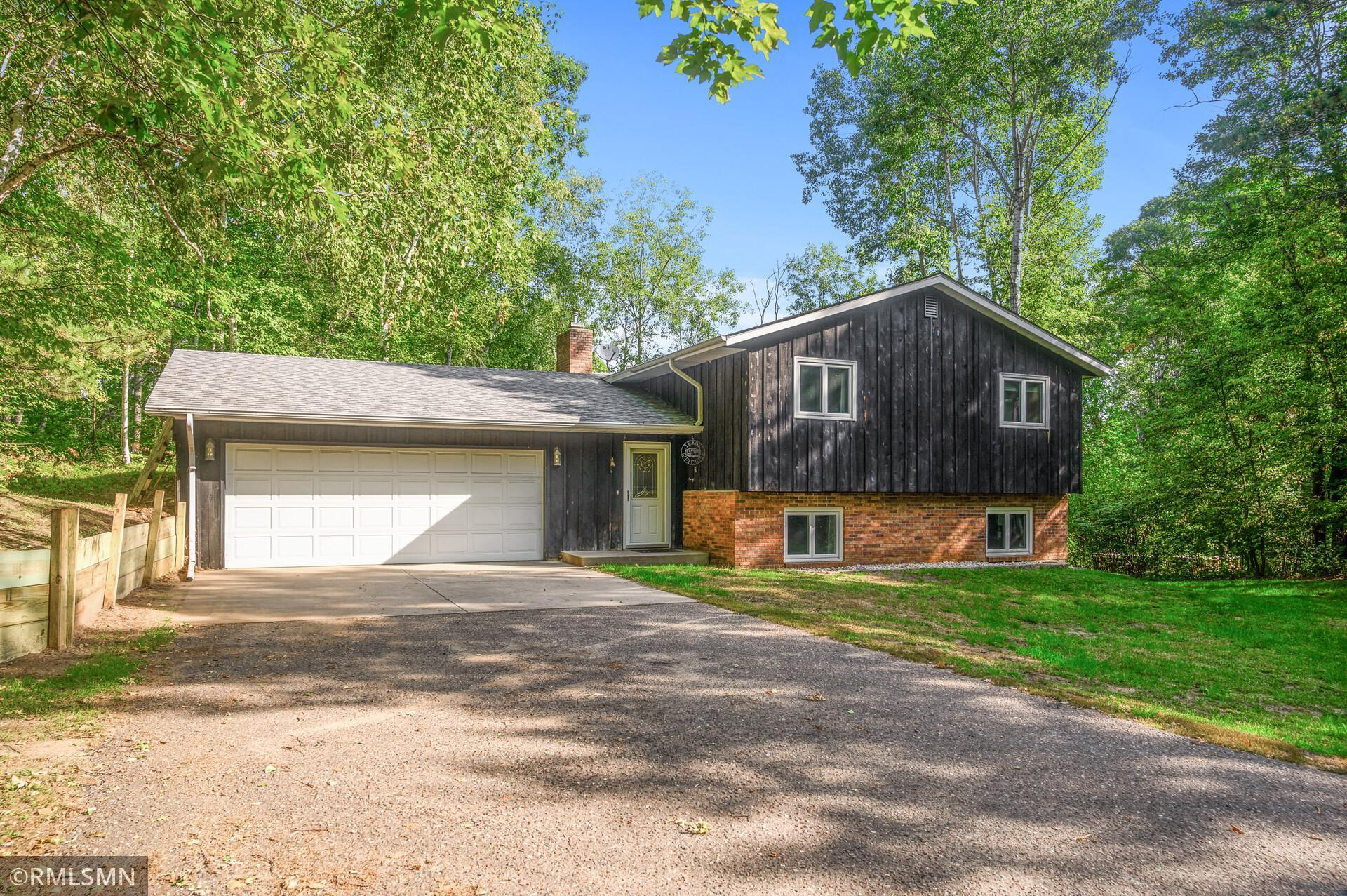 Peacefully located 4 bed 2 bath home on almost an acre lot. This home centrally located has a large garage, huge 3 season porch, two fire places.