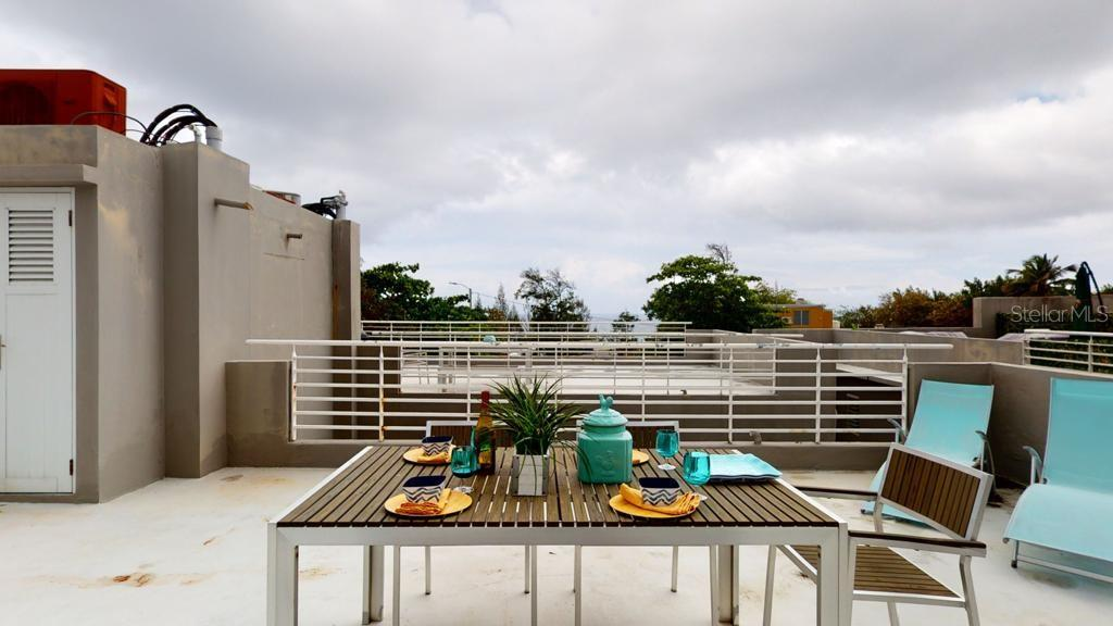 """This 1,562.04 sq. ft. consists of 853.16 GLA with an outdoor front balcony, integrated living-dining-kitchen area with a laundry closet, 2 bedrooms and 1 full bathroom; totally renovated & furnished (except artwork and accessories), includes appliances (S/S Fridge - S/S Stove with Oven – Microwave – Washer & Dryer - Water Heater - 3 High Efficiency AC Units and a Water Cistern) with a private mega 708 sq. ft. open terrace with beautiful views, perfect to entertain and/or relax. Condo permits short-term rentals and the location makes it an ideal Airbnb Rental Property. Situated between Old San Juan and El Escambron Beach and only steps away from the """"Paseo de la Puerta de San Juan"""". Prospective Buyers should be informed that the price is firm and condo qualifies for Conventional Non-Conforming loans."""