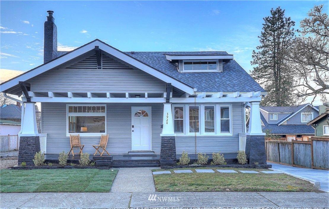 Stunning, charming, like new! 4 bed (+office)/2.5 bath (3018 SF) Craftsman home extensively remodeled w/ a gorgeous NEW kitchen incl white cabinets/quartz counters/island/pantry/stainless appls, an XLRG great room w/ FP, a main flr office, a main flr master w/updated bath, 3 upstairs bdrms w/ an updated bath, an enormous full bsmt for future expansion (rec rm, music rm, storage, shop), a front covered porch (bring your swing), & a spacious backyard. 100% new plumbing/water tank, elec/lighting/panel, 90% gas furnace, & interior finishes--flooring, insulation, drywall, paint, tile, trim & doors, fixtures & finishes. Turn-key, move-in ready! Close to waterfront views, walks, local schools, Jane Clark park, Pt Ruston, and Pt Defiance. Turn key!