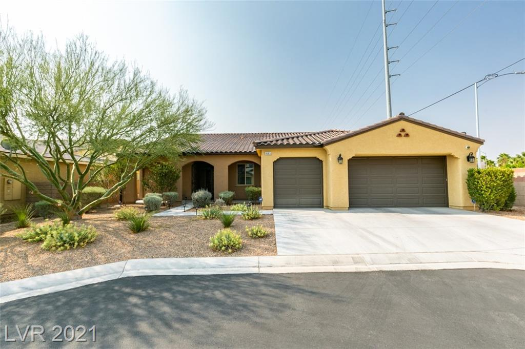 This 1-story home built in 2013 sits at the end of a cul-de-sac in a small gated community built by Pardee with only 30 homes. Wood laminate flooring throughout the entire home with the exception of tile in the bathrooms and laundry room. The kitchen includes granite counter tops, high backsplash, large island with seating, built-in oven and microwave, and pantry.  Great room is open to the kitchen and dining room and has crown molding, recessed lighting, and lots of natural light from several windows providing views of the backyard. Spacious backyard is complete with pavers, synthetic grass and large covered patio area.  Primary bedroom has a walk-in closet with custom shelving. Primary bathroom with dual sinks, large separate shower and tub. 2nd bedroom has an ensuite bathroom. 3rd bathroom has dual sinks. Lots of storage between the closets, large laundry room and hanging racks in the 3 car garage. Den or living room provide flex space for an office, game room, etc.