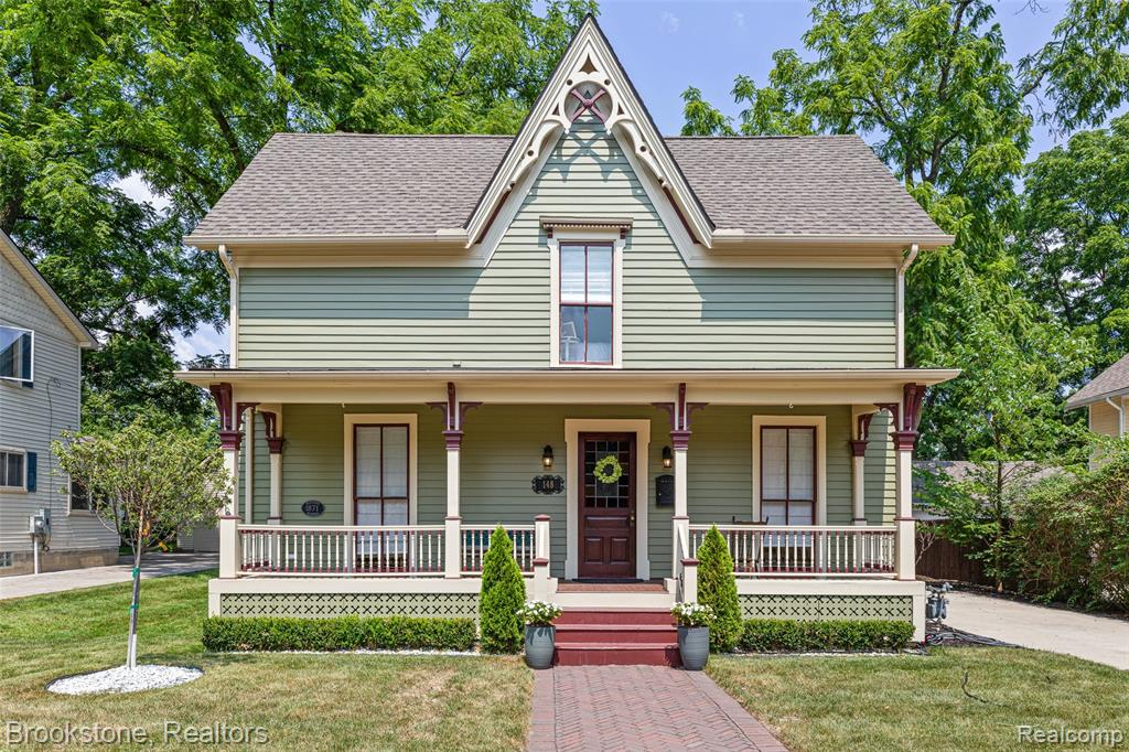 """Beautifully kept, historic Victorian on Tillson Street in Downtown Romeo! Built in 1871, this home has all of the charming details you could expect from a home in this era - stained glass windows allowing lots of natural light, hand-carved doors, knotty pine hardwood floors, wainscoting throughout - but with some massive updates! Beautiful chef's kitchen includes granite countertops and backsplash, Thomasville Cabinets, Wolf dual-fuel 42"""" range, accompanied by a Wolf built-in microwave drawer and 36"""" Sub Zero Refrigerator. Bathrooms also feature nice upgrades as well. The 2-car garage also includes an upstairs loft for additional storage or bonus space. Updated plumbing, electrical, and HVAC. Many furniture pieces are available for purchase as well. While this home is walking distance from Downtown Romeo, the excitement builds on Tillson Street during October when each home is decorated with elaborate Halloween scenes (decor incl), attracting visitors from all over!"""