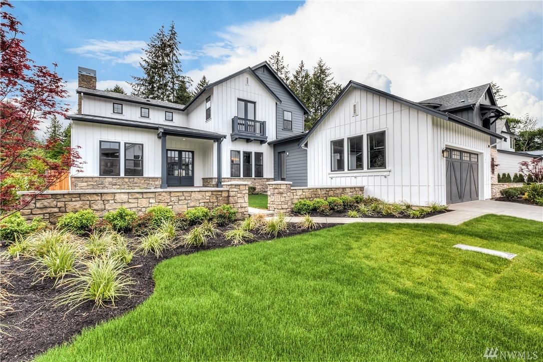 Master-on-the-main! Experience the next level of NW Farmhouse living. Each feature has been thoughtfully selected by design experts to please the most sophisticated of tastes. This special home boasts the style of reclaimed wood cabinetry & lots of marble! Master w/fireplace & spa bath, guest suite, formal dining, office w/built ins and great room w/soaring ceiling. Thermador professional kitchen appliances, custom cabinets. Covered deck w/FP; Leading edge HomeSmart® technology included.