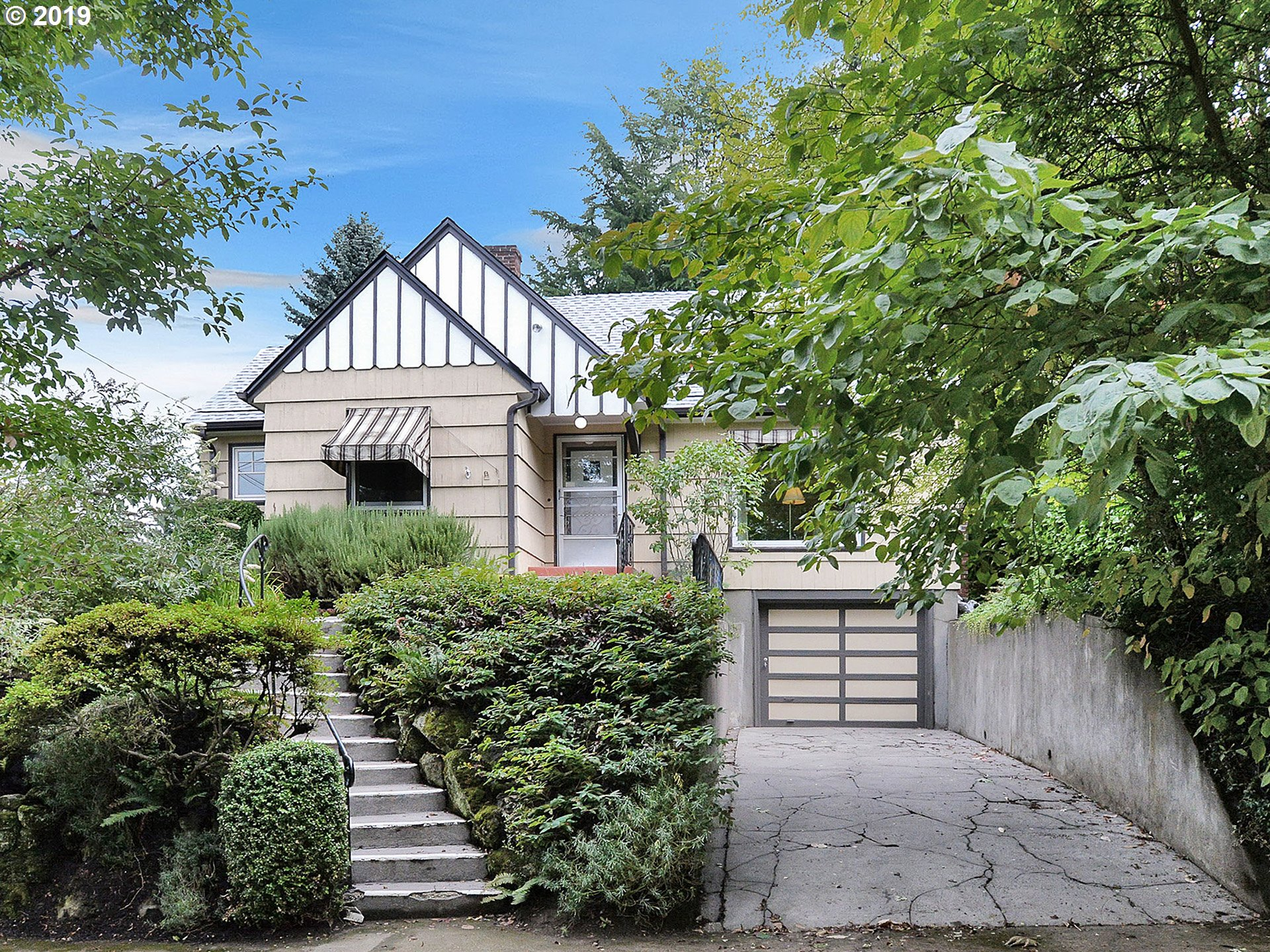 Charming English in Center/Mt.Tabor Heights with modern updates. Hardwoods, built-ins, high ceilings. Close to shopping, cafes, Mt. Tabor Park, & public transit. New tear-off roof, geothermal heating, many new windows,gorgeous hardwoods in living & dining, unfinished high-ceil basement for future potential, extra deep garage, private fenced yard.  Fantastic neighborhood! [Home Energy Score = 5. HES Report at https://rpt.greenbuildingregistry.com/hes/OR10048735]