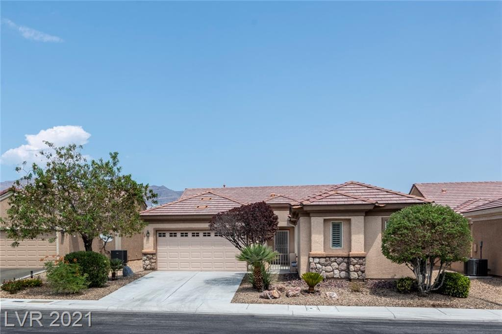 **ELEGANT SINGLE STORY HOME IN SUN CITY ALIANTE** 3 BEDROOM + DEN, 2-CAR GARAGE & A DETACHED CASITA IN A GATED COURTYARD** LOTS OF NATURAL LIGHTING THROUGHOUT** TILE & LAMINATE FLOORING* *PLANTATION SHUTTERS** CALIFORNIA CUSTOM CLOSET IN THE PRIMARY BEDROOM** OPEN FLOOR PLAN W/ A GREAT ROOM, SPACIOUS KITCHEN W/ GRANITE COUNTER TOPS, BREAKFAST BAR, PANTRY & RECESS LIGHTING**BACKYARD FEAUTURES COVERED PATIO & LUSH MATURE LANDSCAPING**  STATE OF THE ART FITNESS FACILITIES, INCL TENNIS AND PICKLEBALL, POOL TABLES, LIBRARY ROOM, CONFERENCE ROOM, PING PONG TABLES, OLYMPIC SIZED POOL, 40+ CLUBS PLUS A CITY OWNED 18-HOLE GOLF COURSE** MOMENTS AWAY FROM ALIANTE HOTEL & CASINO**