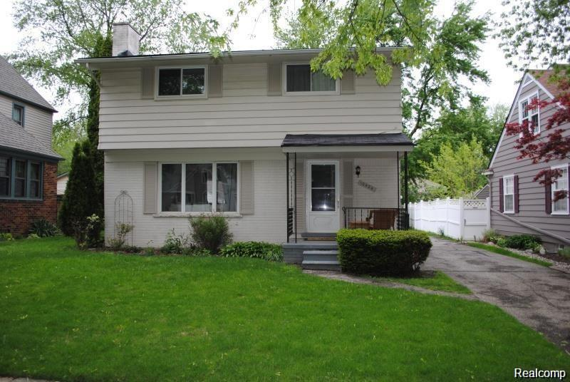 Four bedrooms, one and a half baths. Finished lower level family room and living room both with fireplace. Hardwood floors in living room and dining room. New baths and kitchen. Central Air. Fenced private back yard with patio. 2 1/2 car garage and new driveway. Agent is owner.