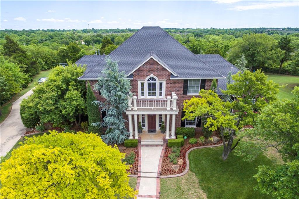 Grand executive home in the desirable gated Shadow Ridge addition. Lots of room to roam inside and out on this gorgeous wooded 1 acre lot. This true 5 bed, 4 bath home also has a large bonus/media room upstairs along with 3 bedrooms. Master, a junior suite and the study are downstairs. The beautiful sweeping staircase with black iron banister as you enter the home is an ideal setting for pictures. Gorgeous wood floors in the formal dining, formal living room, and second living. Chef's kitchen includes a 5 burner gas cook top, double ovens, pot filler and a butler's pantry, with a wine fridge, between the kitchen and formal dining. Easy access to the backyard from the large master bedroom, the kitchen/dining area or from the utility room. Two large decked attic areas accessed from the upstairs walk in closets. Enjoy your time in the heated salt water pool. Ready for storm season with a generator and storm shelter. Convenient location in the metro with quick access to Kilpatrick & I-35.