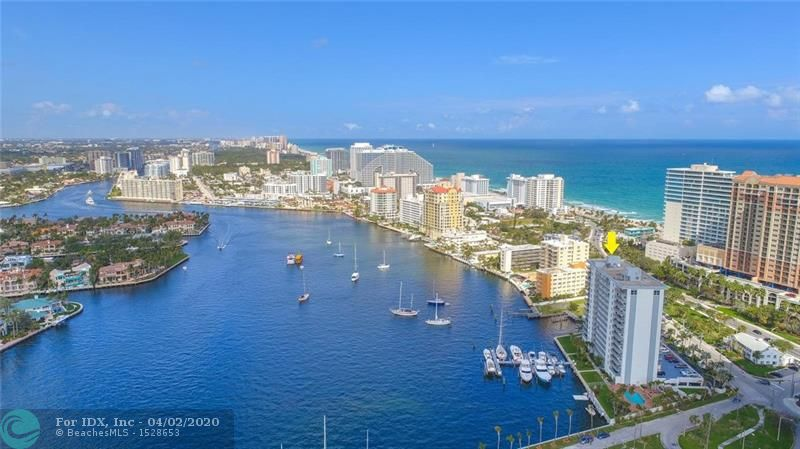 Prepared to Fall In Love....Not only does this unit offer Sweeping Views up and down the Intracoastal waterway, but the Ocean and Beach views of Fort Lauderdale beach are spectacular.  But the inside will knock your socks off.  High end Renovation recently completed.  Beautifully appointed Bathrooms, Back lit Crown Moldings, Impact windows and Sliders installed in 2014.  A/C Updated in 2014.  Spacious Patios to maximize our views, Both East and West Facing.  Semi Private Elevator and Foyer shared with C Stack only.  Washer and Dryer off Kitchen.  Single Car garage parking and plenty of guest parking on the second floor. Dock Space Available to lease thru association on first come first serve base. Unit can Be Sold Fully Furnished and Turn Key for 930,000.  Few exceptions on list.