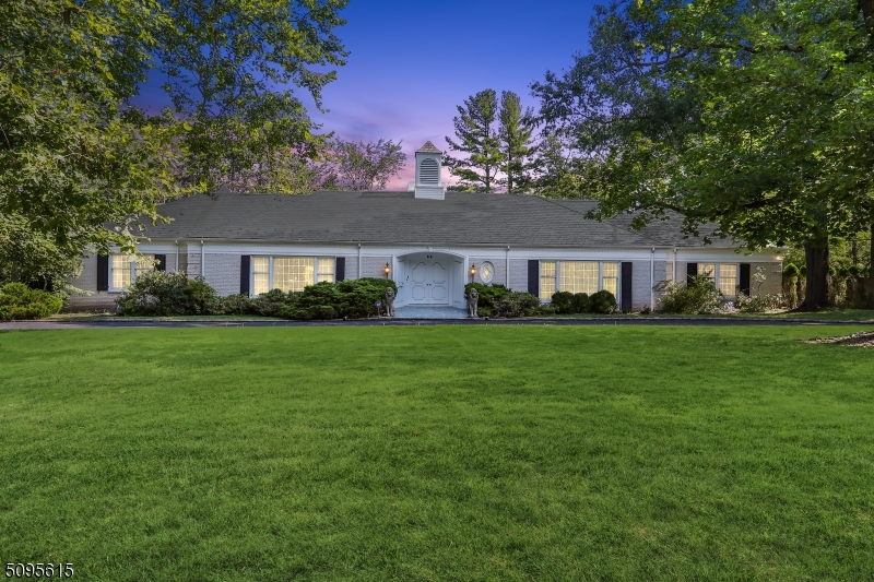 All Brick Ranch with spectacular pool, patio & pool house with great privacy, & rooms of grand proportion offering one floor living at its best!! Double doors lead into gorgeous entrance hall w/ great natural light & gallery hall w/ double sided fireplace & bar. Sun-soaked living room leads into the dining room, perfect for entertaining. Large sunlit eat-in kitchen has sliding doors to the spectacular patio & pool, in an idyllic, private setting. Great guest/in-law suite w/ seperate access via a side door. Access to 4-car attached garage. Master Bedroom suite has sliders to the patio & pool and 2 beautiful full baths, each with a WIC. 2 more bedrooms each have a full bath & WIC. A large office with built-ins completes the great floor plan. Ideally located in highly rated Deerfield Elementary School district!