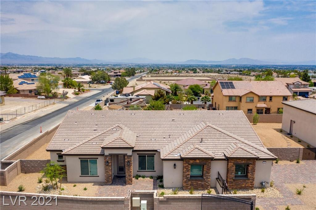 """NEW Liberty Home w/52' RV garage(A/C, full hook-up) over 5190sqft under roof! Half-acre in gated community w/NO HOA. Great NW location near 215. Open plan w/10' ceilings, crown molding & 8' doors. Stone accent wall & floating shelves in Great Room w/62"""" linear gas fireplace & 3 panel glass door. Chef's kitchen w/SS appliances, full overlay, soft close, full access cabinets to ceiling, cabinet lights, pull-outs & spice racks, island & breakfast nook, built-in pantry w/frosted door. Wood-looking tile, designer accent walls & quartz countertops throughout. Spacious Owner's retreat w/built-in closets, dual sinks, sitdown vanity, rainhead shower & 6' soaking tub. Built-in Mudroom, oversized laundry/hobby/pet room, Den & Dining room. Central vac, cameras, alarm & secret room w/Maglock. Pavestone driveway, gated courtyard, & large back patio w/ low-maintenance landscaping. Energy efficient construction: tankless water heater, R38 ceiling & R25 rated wall systems. 18 mo. LEASE-BACK OPPORTUNITY"""