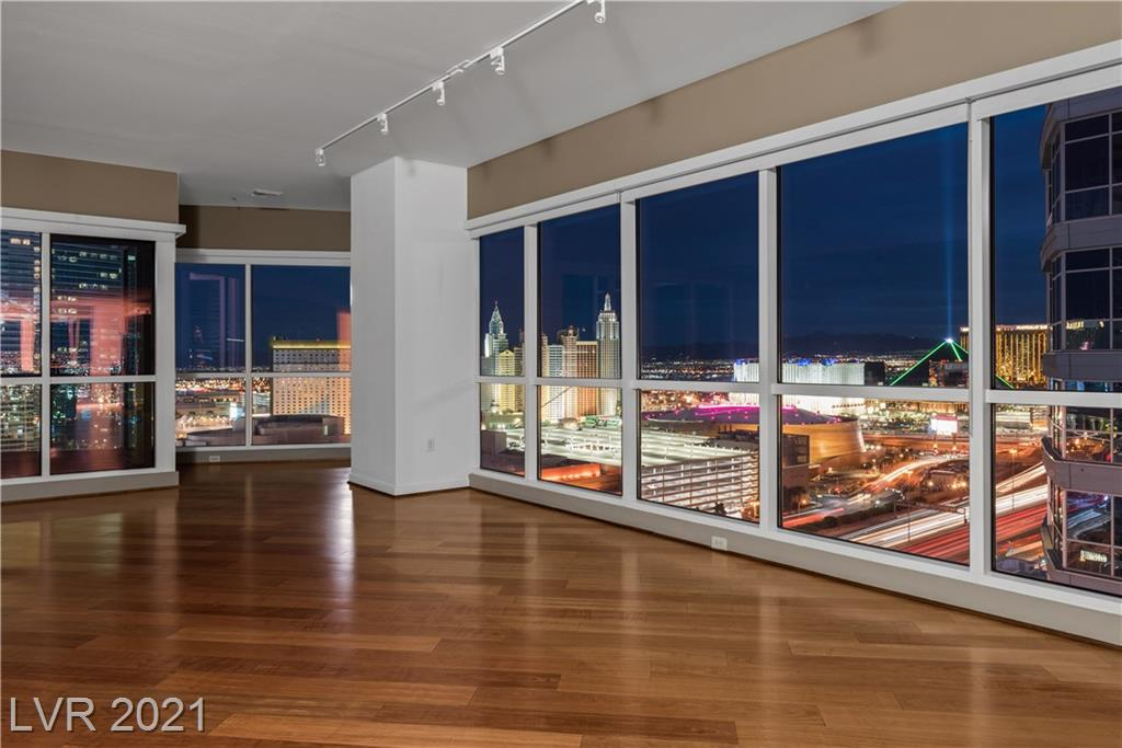Superb corner unit condo in Panorama with truly exceptional views. This is the best floor plan in Panorama towers and this particular unit has been finished to an exceptionally high standard. There are wood floors throughout, ample built-in cabinetry, a large kitchen as well as a great sized master suite and secondary bedroom. There is also a den off the kitchen - all with outstanding views of the strip and the surrounding mountains. There are also 2 parking spaces included as well as a storage unit.