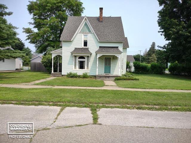 Offer in place is subject to 72 hr contingency clause.  Charming 2082 sq ft Victorian home located on a corner lot with an attached 2 car garage and fenced in back yard.  The yard has established landscaping including perennials and hedges.  The interior is spacious with good sized rooms and character, including a natural fireplace in the living room.  Two full bathrooms one on each floor.  Lots of closet space.  Home does need cosmetic updating.