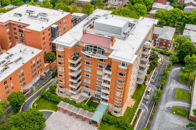 This elegant townhouse condo is in one of the finest full-service buildings in Clayton. The property was completed for the owners by combining the 4th and 5th floor units into one 2-level unit. Private, interior elevator in the unit. The design makes great use of the space, providing a nice flow on the 1st floor for entertaining, while giving privacy to the 2 well separated bedrooms upstairs. Neutral white kitchen with a center island & adjacent wet bar opens a family room. Off of the dining room is 1000-bottle wine room. The living room has a gas fireplace & an expanse of windows and door to a large terrace. The 2nd floor has a 2 bedroom suites & a laundry room. The master suite includes a bathroom with double sinks, separate shower & an air-driven jacuzzi tub, expansive master closet & a 2nd terrace. 3 garage spaces and 2 storage lockers. Building amenities include: 24-hour doorman, heated pool, exercise room, party room & 3 guest suites.