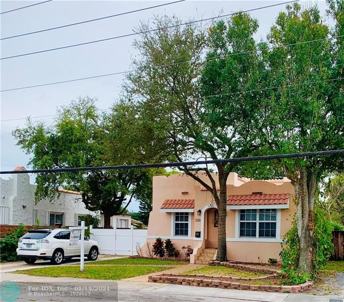 """House has been remodeled for you. One of Largest 2 Bdrms in area @ 1152 sq. ft +300 sq ft Rear Porch and 400 Sq ft. Back patio. Has 2nd remodeled bath(most only 1)Hurricane window & doors. Sprinkler with well water, lower water bill $$$ Freshly painted inside and out. Roof sealed and painted. Kitchen all SS appliances, granite counters. Kdown walls. Blinds on all windows Sec lights, Ring doorbell. Zoning is R-15. Huge lot alley behind the property.Build or room pool. Huge mature Avocado tree and plants. All paddle fans with remotes. Easy to show. Loads of storage. Sheds in backyard with 2nd refrigerator for """"Party Time"""". Chicago Brick accent frt driveway. Best Location, near beaches I-95, airport and downtown. All shopping close. Wonderful neighborhood great neighbors Bring all Offers!"""