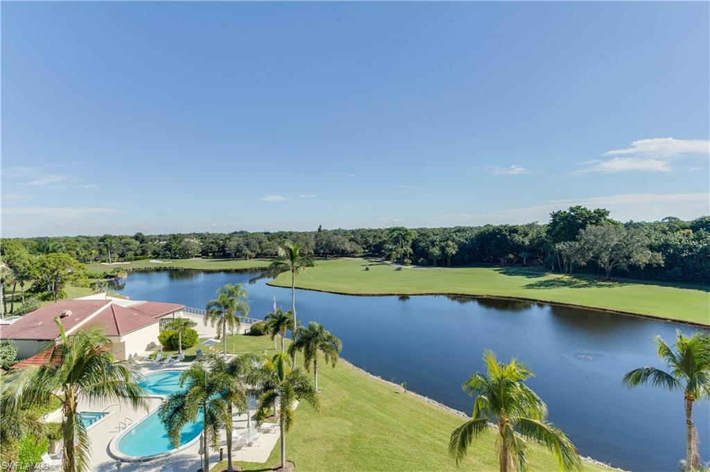 """C. 550 - Treat yourself to splendid sunrises over the Pelican Bay golf course and sunsets over the Gulf! This penthouse gem is optimally situated to capture panoramic views both East and West and is just across the street from the tram or a 10-minute walk to the beach. Exquisitely updated, the 2 BR/2.5 BA open floor plan offers comfortable living space with high ceilings and the latest in fine details. Additional """"flex"""" space offers an option for a dinette, sitting area, bar or office with a view of the Gulf. New features include: Emola Italian tile and hardwood flooring, hurricane-impact windows and doors, Cambria quartz-topped built-in bar and storage area, motorized Silhouette and panel shades, and more. An oversized sumptuous master bath features marble throughout with Blue Pearl granite countertops. A newer A/C, water heater and fresh paint add luster to this very special penthouse. The unparalleled amenities of Pelican Bay are steps away: beachfront dining, beachside attendants, kayaking, tennis, state-of-the-art fitness center, and more. Artis Naples, Waterside shops & restaurants, and Mercato are also at your fingertips. This is Florida living at its best!"""
