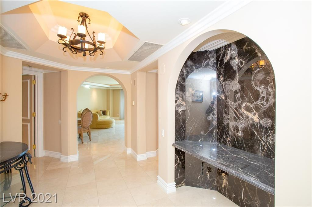 Upgraded 23rd floor unit in Tower 1 - Wynn golf course & strip views, all marble floors, carpet in 2 primary bedrooms with jetted tubs & sep showers. Double lighted crown molding. Recessed marble niche in foyer, powder bath.