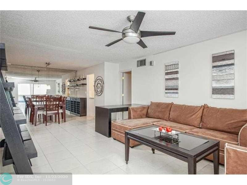 PRIME LOCATION IN A GATED COMMUNITY, 24 HOURS SECURITY, 4 HEATED POOLS, 3 REMODELED CLUB HOUSE, STATE OF THE ART GYM, TENNIS COURTS, PUTTING GREEN, BIKE STORAGE OUTSIDE, POOL AND CABANA BAR ON THE INTRACOASTAL, ENJOY AND RELAX WACHING THE BOATS GO BY. AFFORDABLE BOAT DOCKAGE AT $1.50 PER FT PER MONTH WITH NO FIXED BRIDGES. CLOSE TO BEACH, SHOPPING, DINING,  ************ABSOLUTELY FABULOUS FURNISHED UNIT. WASHER/DRYER IN UNIT, ALL TILED, HURRICANE IMPACT WINDOW. ALL YOU REALLY NEED IS YOUR TOOTHBRUSH.