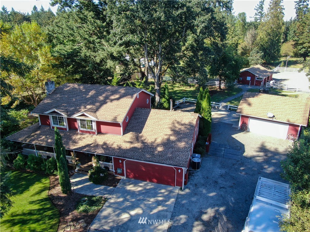 Secluded Equestrian Paradise in Highly Desirable Rainier Oaks Estates! Enjoy the mountain view as you ride in the 80X120 buckshot & sand arena w/sprinkler & night lighting! 4 stall barn, heated tack rm, fenced & cross fenced & hot wash rack! MIL Possibilities or Home Office in Detached! Enjoy morning coffee on wrap-around porch, back deck BBQs & wildlife sanctuary gardening! Turn-key 4 Bed, Lrg Master, fireplace, A/C & Invisible fence! Quiet serenity & still close-in for commuters! A MUST SEE!