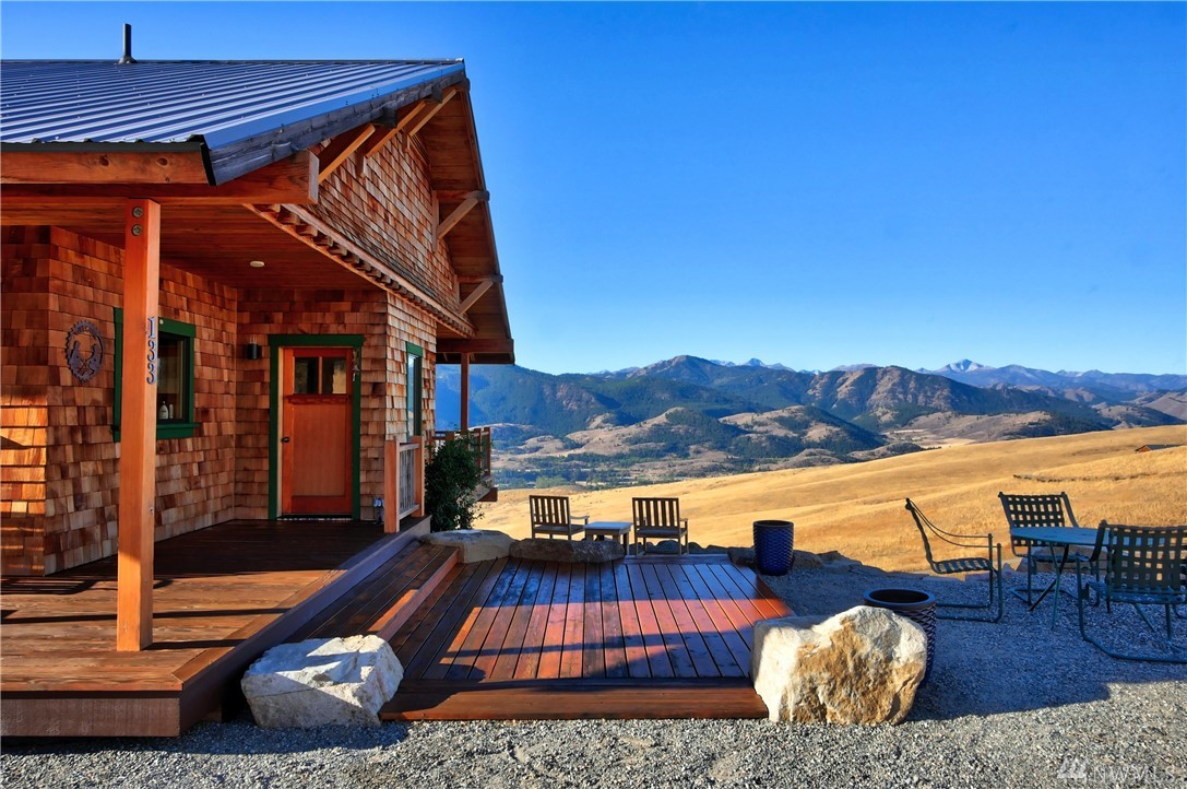 Million dollar view of snowcapped peaks! Beautifully appointed custom home w welcoming interior of vertical grain fir cabinets, doors & trim, granite counters & stainless appliances. Wall of windows capture the weather play across the Methow Valley! Spacious Master bdrm on main floor w private deck access, ensuite bathrm & walk-in closet. 2 lg bdrms each w bathrm plus great room wired for entertainment on lower level. Excellent hi-speed internet. Only 15 minutes to Winthrop & trail system.