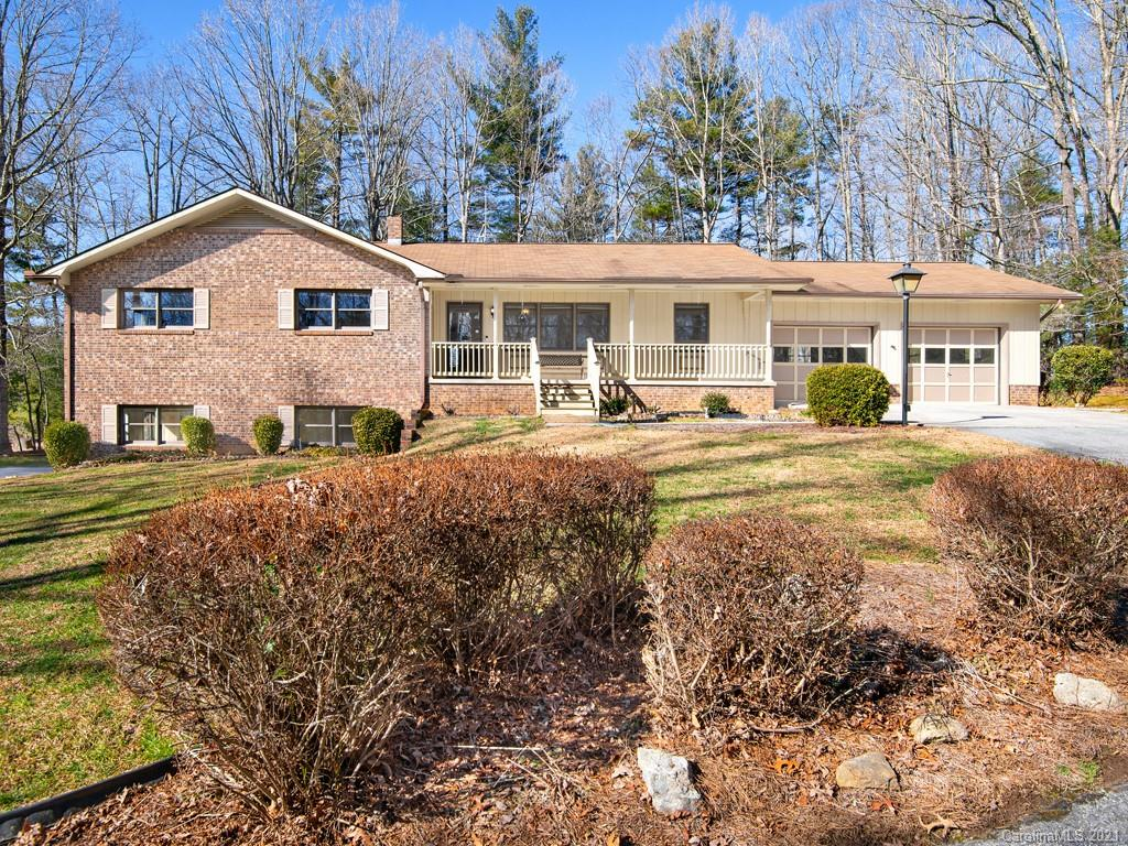 Classic brick ranch in Lakemont subdivision. The main living level of this home features 3 bedrooms, 2 full baths, plus an office, eat in kitchen, living room and laundry room with a half bath. There is a spacious 2 car garage on the main level, plus and additional 1 car garage in the basement. There is a family room in the basement with central heating and air plus a woodstove and this room could be easily finished off to add additional heated square footage by adding flooring and a little carpentry around the woodstove. The rest of the basement is spacious for a shop or other uses and has an existing toilet, sink and other rough plumbing. Other features include a covered front porch, back deck with patio and awning, automatic generator, an outbuilding and a carport shed. Located just a short distance to the Green River Game Lands, a NC state forest with over 14,000 acres and a poplar destination for fishing, hunting, hiking, and white water recreation.