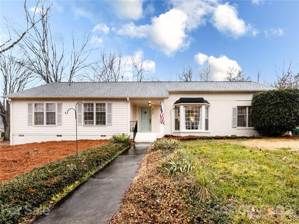 Don't miss seeing this fantastic ranch with modern updates and spacious rooms. Covered front porch entry to a designer wallpapered foyer which spills into formal areas. The dining room has a large bay window and gorgeous light fixtures. An office space leads you to an open kitchen and great room area. The kitchen has been fully updated white shaker cabinetry, stainless appliances, a center island, and quartz countertops.  Large laundry/drop zone off the kitchen.  The great room features a centerpiece painted brick fireplace and offers an adjacent sunroom with adjacent flex space. Four spacious bedrooms down a private hall with an updated shared full bath. Master bedroom offers a large closet and an ensuite featuring shower, new tile flooring, and new vanity. Outdoors you'll find a covered porch perfect for relaxing and entertaining, as well as a large storage shed in the rear yard. Located in a great spot close to SouthPark and Matthews shopping, dining and greenway access.