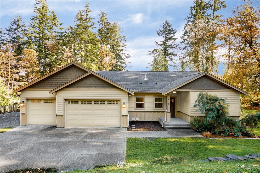 Welcome Home to this Beautiful, Spacious Rambler with a Basement located on Fox Island with NO HOA! This home features nearly 3,600 square feet of well thought out living space on over an Acre of secluded property. The Main Floor features Hardwood Floors throughout, an Office/Den, Guest Bathroom, Dining Room, Laundry Room, Family Room w/ Gas FP, Kitchen w/ Eating Nook and the Master Suite; which includes Two Walk-In Closets, a 5-piece En-Suite Bath and Beautiful Views of the Property. There is plenty of room for everyone in the Daylight Basement featuring a Large Finished Room perfect for a Home Office or Gym, Rec Room, Two Bedrooms, and a Full Bathroom. Enjoy the serenity of this Fox Island property, yet close to Point Fosdick Amenities!