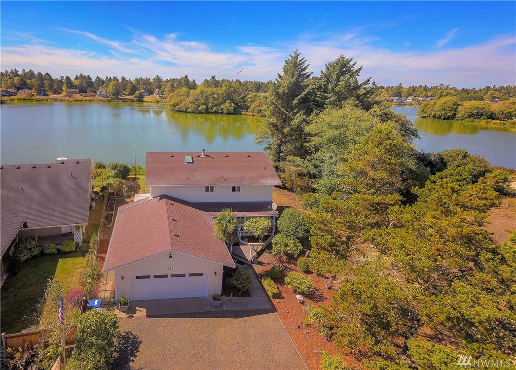 Beautiful waterfront home in wonderful Ocean Shores, Washington.  Stunning views over the wide part of Duck Lake and the uninhabited islands.  Everything is ready to move in and the home has been very well maintained. Multiple living areas, including a formal dining room and a lake view sunroom.  Enjoy the waterfront in your backyard with a picturesque gazebo and a large dock ready for your boat. Awesome location on the lake.