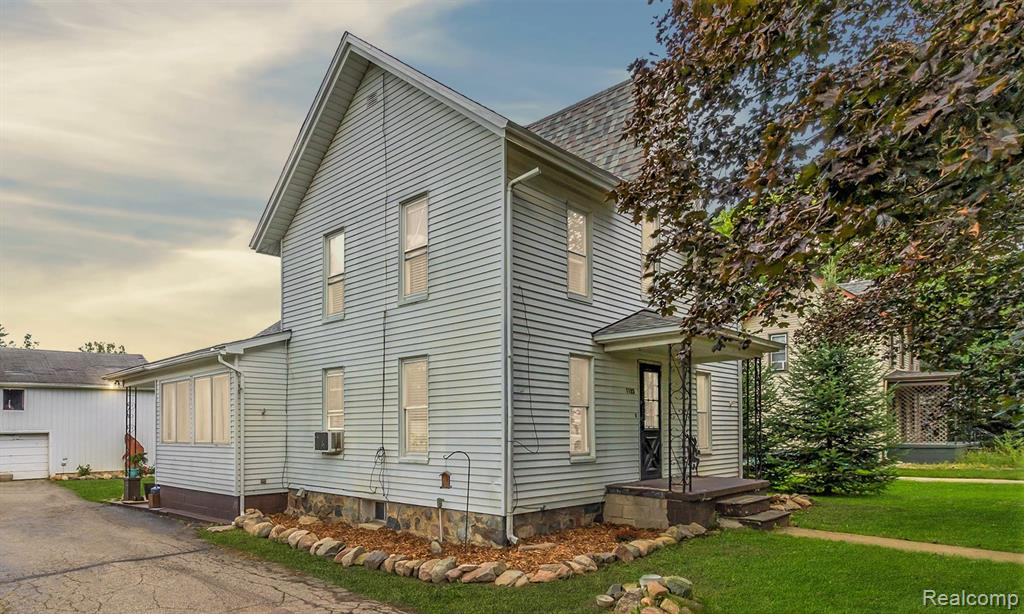 """Beautiful Howell victorian style home on just under a half acre beautiful lot and backing to the woods.  It definitely seems much larger than .46 acres! Such a peaceful setting! Pole barn/garage w/2ndstory """"man cave""""! It makes the perfect mechanics workshop or shop for woodworking! Wood burner to stay but needs a chimney. Many updates have been completed over the last few years such as new furance, new hot water heater, new roof in 2020, upper bedrooms/second floor remodel with new  flooring & newer windows too. 1st floor master bedroom and two large bedrooms upstairs. You will love the large open kitchen with a gorgeous original arched window and the beautiful original wood floors!  Large dining area in kitchen and additional office area off kitchen that could be converted to an amazing mud room.  You will love the rustic original brick chimney in kitchen. This home is so very unique and a must see! Basement has a cellar with a walk up access to outside. All measurements & data approx"""