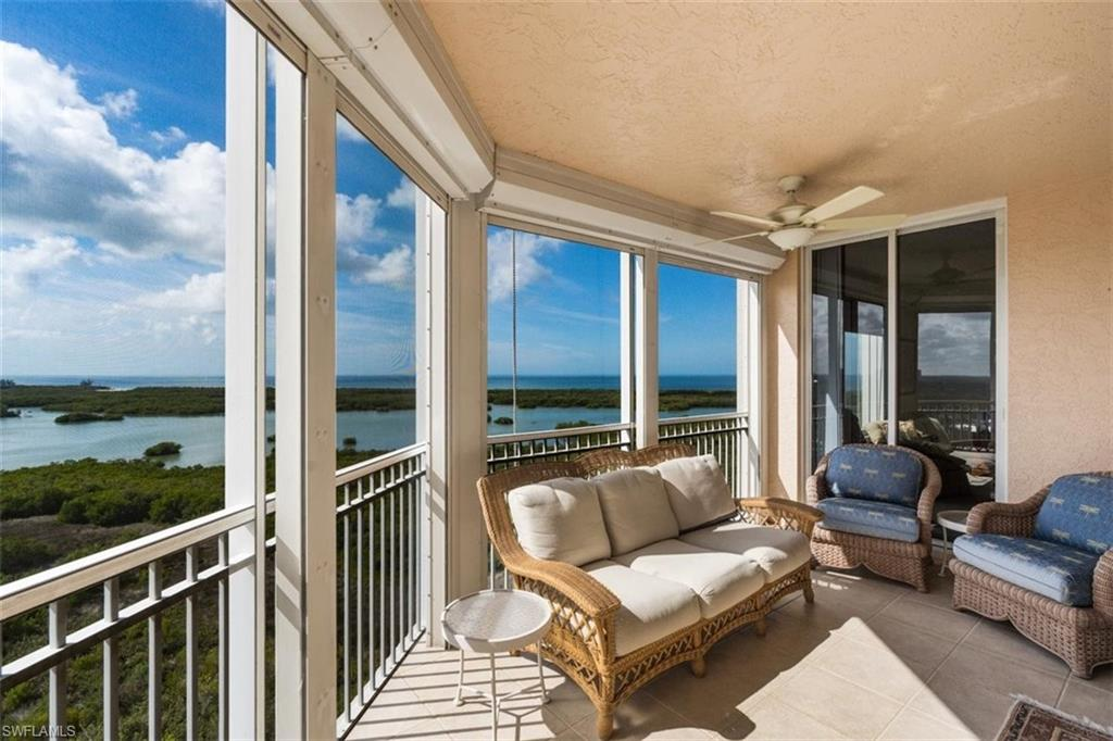 C1145 - Significant Price Improvement! Admire the dazzling Gulf of Mexico and Estero Bay views from the wraparound screened-in balcony of this spacious 14th floor and desirable end unit in this active adult community. Features open great room with living and dining, electric hurricane shutters and Garage conveniently located near building entrance.  Exceptional amenities include the 17th level Top of the Point Club overlooking the Bay and Gulf where you can socialize and participate in the Hodges University Lifelong Learning classes. On-site assisted living and round the clock emergency monitoring by the highly rated Assisted Living facility at Arbor Glen. Enjoy use of all the facilities including fine dining, salon, private fitness center, library, health center, clubhouse, shuffleboard, bocce and tennis court.