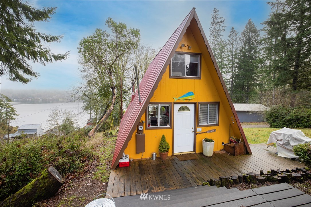 """Private island retreat! Cute remodeled A frame cabin located on the east side of the island with a very open view of the water!  Main floor consists of open plan living/dining/ kitchen, 3/4 bathroom & stairs to a loft bedroom.  Slider door out to a deck.  Included is a 2nd parcel/lot with its own 2 bedroom septic system!  Perfect to build a garage with guest quarters!  The 2 lots measure up to almost half an acre. Herron Island is a private island; only property owners and their guests are allowed with access via the community owned ferry """"Charlie Wells."""" The island has a community beaches, seasonal boat docks, boat launch, baseball field, & playground."""