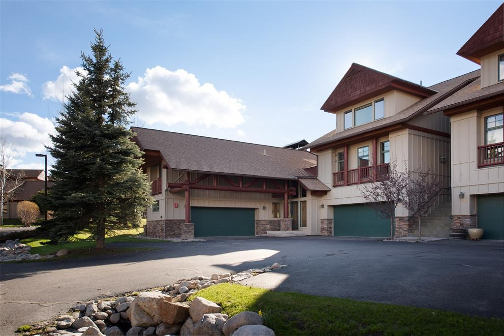 Join the Club at Big Sky favorite meadow condominiums-Crail Creek Club. Fabulous layout offers privacy with main level master bedroom, an upstairs loft and bedroom suite and a downstairs bonus/media room. Soaring ceilings are highlighted by picturesque windows, two distinctive chandeliers, log beams and a stacked floor to ceiling wood fireplace. Open kitchen features an induction cooktop, range, French door refrigerator and plenty of cabinet space. Retreat into the master suite with spa-like bathroom offering dual vanities, a soaker tub and shower. Full laundry room connects with the master bath and walk-in closet. Upgrades abound-hardwood and tile flooring flow throughout; wet bar w/ wine cooler for entertaining. Covered deck with hot tub is protected by large trees and backs to a quiet street. Ideal location to enjoy Big Sky Meadow and Town Center restaurants, amenities, Farmer's Market and Summer concerts. Crail Creek's campus is adjacent to the 10th hole on Big Sky's golf course.