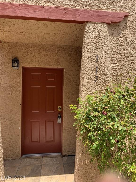 Lovely First floor unit in a Gated community. Shopping and entertainment are within walking distance. New paint and flooring. A must-see!