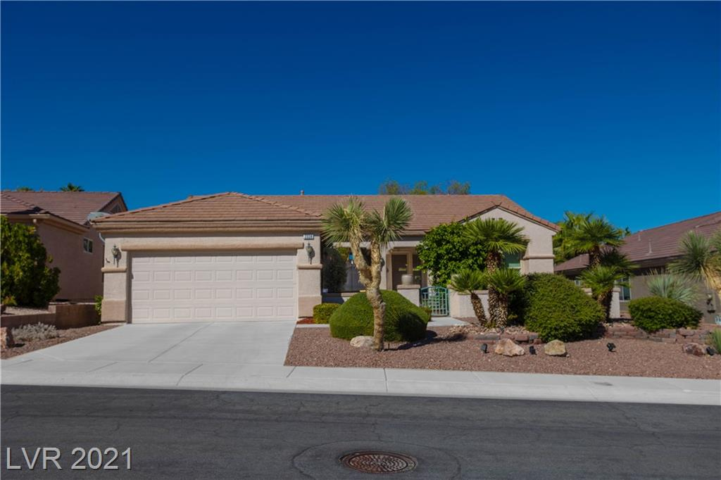 Look no further!  This home is definitely a MUST SEE!  Original owner shows pride of ownership throughout  this gorgeous home.  Spacious and open floor plan with high coffered ceilings in the main living area.   Home has ceiling fans, tile, and laminate. Huge kitchen with pull out drawers, breakfast nook, free standing island, built-in desk, and pantry.  Beautiful great room addition with french doors leading to partially covered patio   Front yard has patio, fountain, flower bushes and lush grapefruit tree.   Enjoy all the amenities McDonald Ranch offers, including club house activities, pool, tennis, racquetball, pickle ball and restaurant overlooking golf course.