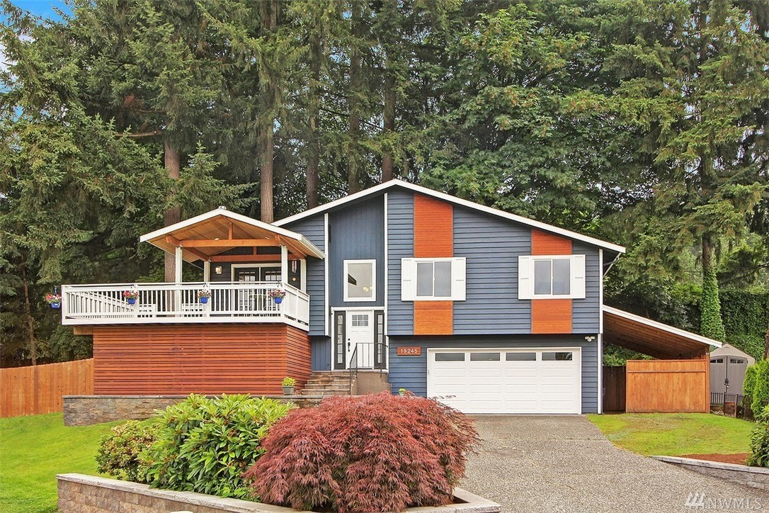 Tastefully remodeled 4 BR/2.75 bath all-gas home on quiet cul-de-sac near Sammamish Beach Club is like new. New kitchen w/ SS appliances. New roof, windows, baths, Jamaican walnut flooring, 95+efficient furnace w/AC and air cleaner, tankless water heater. New paint inside and out.  Large 2-car garage attached. Move right in! Large private yard, play area with slide, 2 entertainment decks. Excellent schools. Easy commute. Near parks and shopping. See more details under photos.