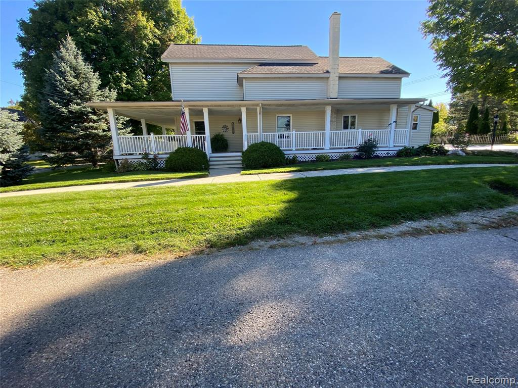 Make this extremely clean, well cared for Village of Metamora house your new family home. Unique features combining older character and newer updates, makes for numerous opportunities to add your own personal touches. 3 large beds (including 1st floor master); 2.5 baths; large country kitchen & dining; storage galore; 2 sided wrap around porch for hanging out/eating/ etc.; 2+ car garage with pull down attic stair for additional storage; nicely finished 3 season room with endless possibilities for family gatherings or additional kid/adult getaway space; well kept yard with room for activities, pool or family fun; newer resealed asphalt drive with additional parking space on side of garage; all appliances included and within walking distance to library, parks, stores and eats, make it convenient to enjoy the village life. 2 hour showing notice to make arrangements for dog. Please remove shoes. B&BATVAI.