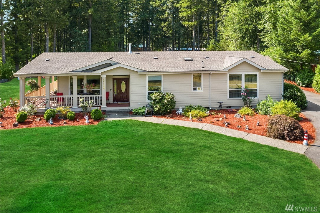 Stunning triple wide on flat, fenced acre + lot. Peak Mt Rainier & foothill views from wrap around porch &huge backyard deck & patio!  Vaulted ceilings & huge, open rms. Island kitchen w/granite counters,stainless appliances & sunny eating nook. Lg master w/5 pc bath & walk-in.  2 more bdrms w/jack n jillbath. Gas fireplaces in both LR & FR. Detached 2 car garage. Mins from 4 corners shops, restaurants &hwy 18. Tahoma Schools!