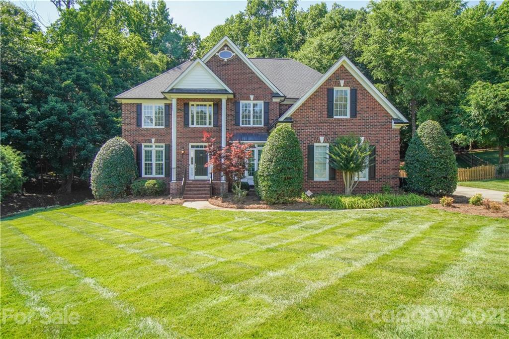 Beautifully maintained all brick home in established neighborhood on 1+ acre wooded lot. Remodeled kitchen and all baths. Double ovens and 5 burner gas cooktop. Built in hutch/wet bar with sink and wine fridge. Freshly painted main floor with completely refinished hardwoods. First floor bedroom can also be an office with french doors stored in shed. Large master with fireplace, ensuite with large jetted tub, separate shower and huge walk in closet. 3 more bedrooms up with walk in closets and newly remodeled shared bath. Great bonus room with pull down attic access and large floored space.  Outside you will find a screen porch, multiple level deck, play gym, 12x16 shed that is wired with its own electric panel, and a gorgeous wooded view! Many more upgrades and features. This home NEEDS TO BE SEEN!