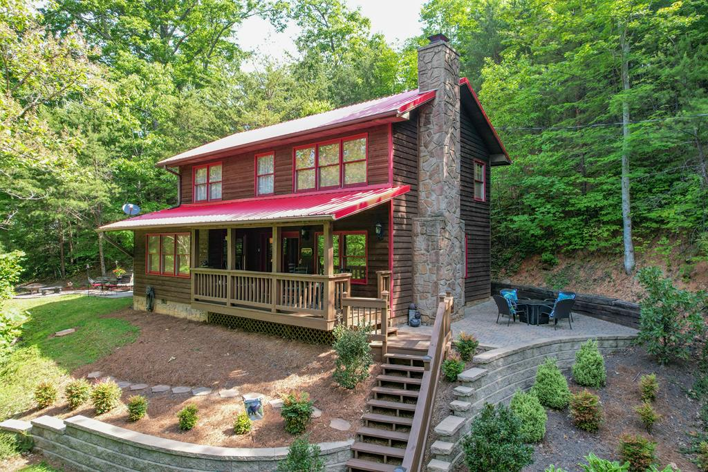 Beautiful 3 bedroom/ 3 bath cabin. Private and peaceful setting surrounds the cabin. Kitchen with stainless appliances,granite counter tops,ceramic tile floorand excess to back covered deck with a hot tub.Exposed beams and wood floors through out.Large living room with a mountain stone fire place. The main level also consist of a bedroom,bath,laundry room and dining room. Second level with a large Master bedroom and a beautiful master bath,another bedroom and bath enjoy the outside with a concrete patio perfect for picnics,grilling and setting by the fire pit. Another gas fire pit on the other side of the cabin.    Cabin has never been rented...