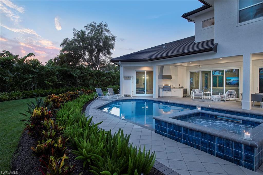 Southern-exposed and a short stroll from Lowdermilk Park, this coastal contemporary has location and style. Designed with natural light in mind, impact-resistant glass windows and sliders frame the entire home allowing for a light, bright atmosphere and views of the lushly landscaped backyard. Impressive 10-foot sliders pocket into the wall create an easily flowing space for entertaining with the kitchen, family room and covered lanai with summer kitchen connected seamlessly. The easy-living floor plan allows the utmost privacy to the master bedroom, which offers a calming space to unwind and a bath outfitted with dual sinks, soaking tub and amazing shower. The kitchen is truly a chef's kitchen with a well-placed wall oven, large center island and lots of countertop space completed with quartz countertops. With five bedrooms plus a den, spacious backyard, covered lanai and plenty of extra parking areas, all of your friends and guests are sure to feel at home.