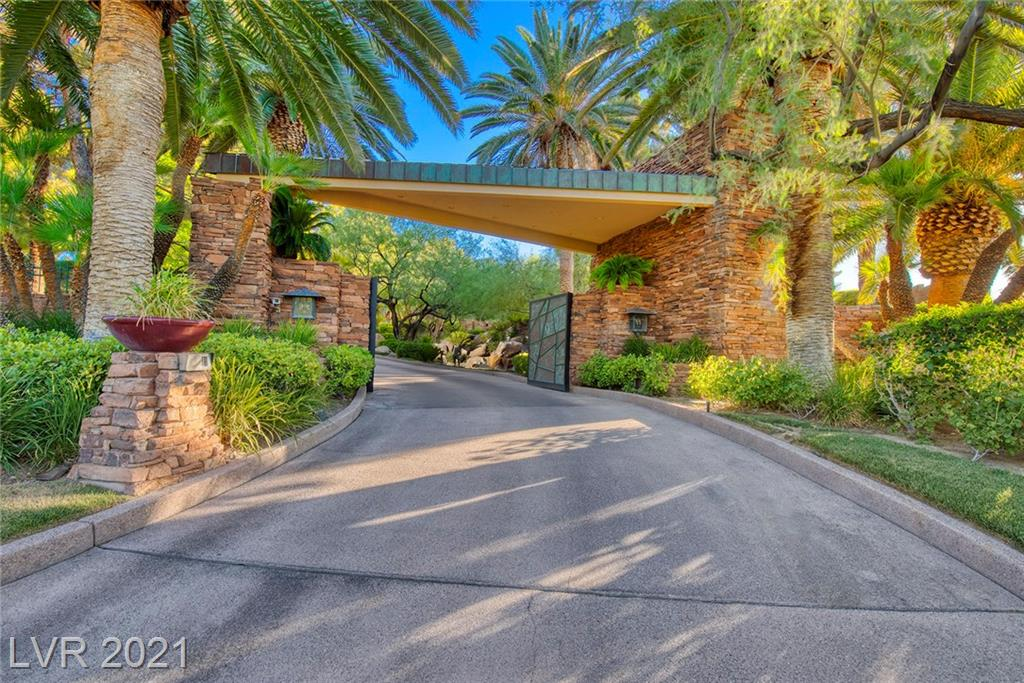 Inspired by Frank Lloyd Wright's Falling Water, this legacy property located in the prestigious Enclave of Summerlin is perfect for entertaining guests and family.  Comprised of over 2,200 tons of ledge stone, this 13,000+ sf home sits on 2-acres of the private TPC course.  This home's amazing gardens and waterfalls run throughout the property, and not only serve as the centerpiece of this palatial home but provide a constant reminder of the true uniqueness of this home in the desert. Impressive vaulted-box, exposed-beam ceilings with recessed lighting adorn much of the home. For entertaining guests and family, this 13,000+ square foot home boasts a great room, a family room, a formal dining room, a wet bar, and a wine cellar/home theater. This Las Vegas home offers both character and significance unmatched in the valley.
