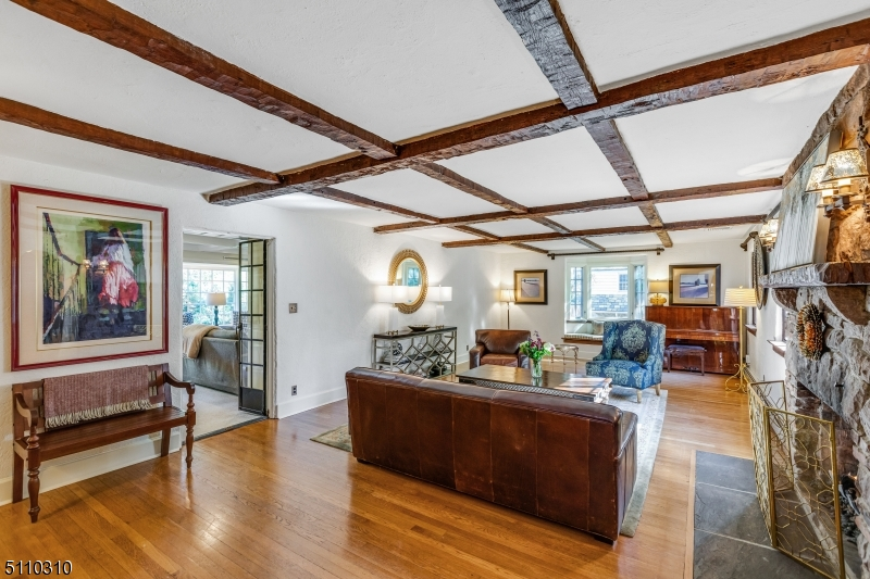 Location, Charm & Character in Short Hills. Stunningly updated modern Tudor with Ludowici tile roof in park like yard.  Charming architectural details, beam ceiling, oversized windows, hard wood floors and large rooms. Custom built-ins, Fireplace and large inviting family room leads to a beautiful stone patio and a private fenced in outdoor space. Gourmet kitchen, large sun filled breakfast room with custom bar & cabinets, and formal dining gives abundance of private and entertaining space. Master Bedroom with walkin closets and master bath with additional bedrooms with their own en suite bathrooms. Finished basement with laundry and LL w/ laundry, wine cellar, game & recreation room. Fantastic location-close to NJ Transit, downtown Millburn and Schools.